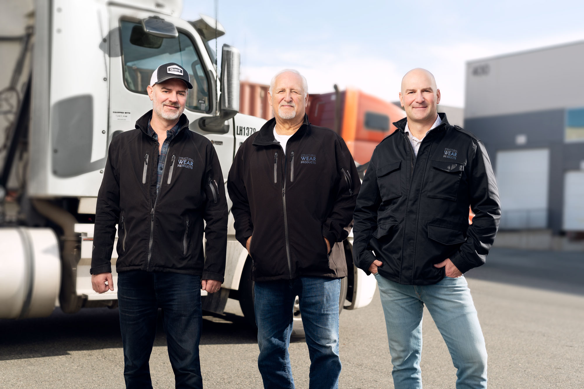 Mike Kirby, Brian Kirby and Chris Kirby standing together at Structural Wear Products