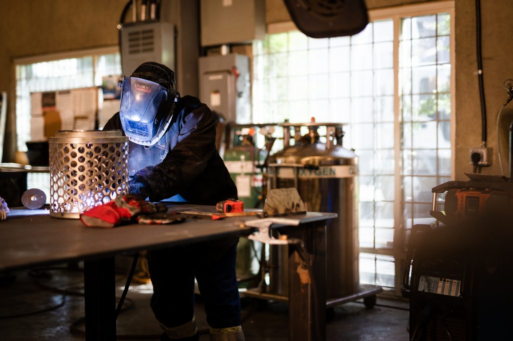 A welder welding a steel component