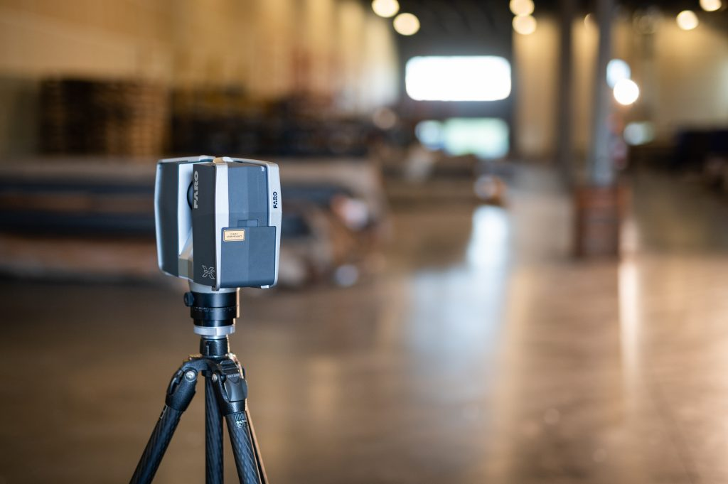 A FARO Focus3D X 330 scanner set up in the warehouse at Structural Wear Products